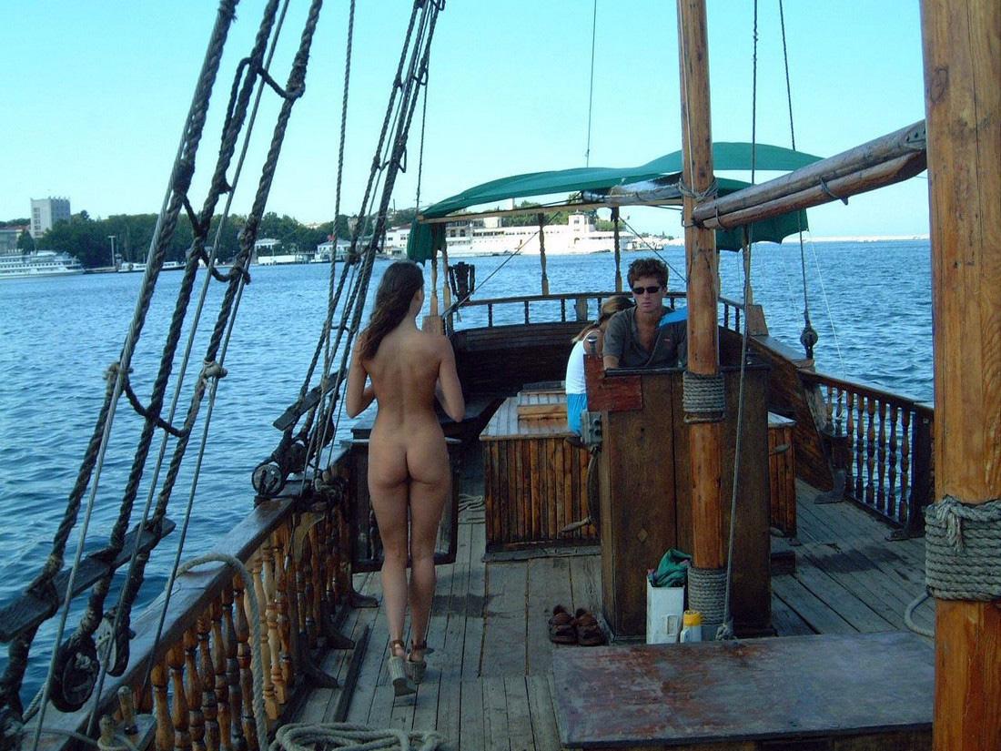 Captivating nubile posing naked at..
